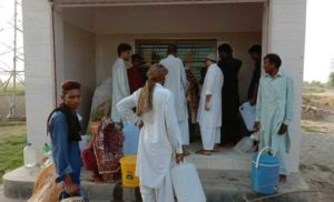 People Collecting Water