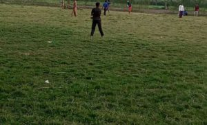 Youth playing cricket